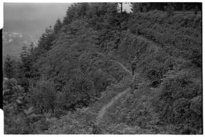 Villager walking along hill side path at Jiangling (Leica M6 + 50mm f2 Summicron + Kodak Tri-X)