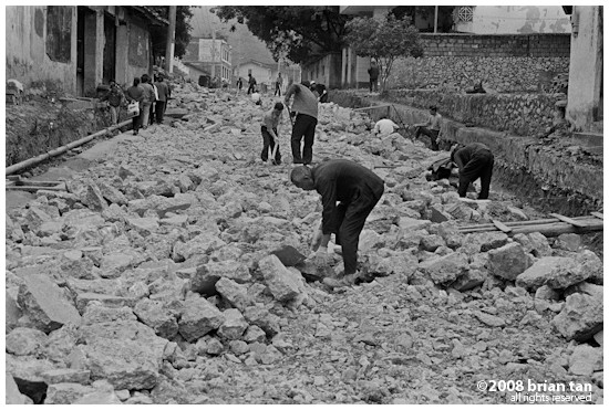 Workers repairing (or rebuilding!) a road in Fuli