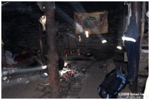 Interior of stone hut, walls are not perfectly sealed, so in the morning rays of sunlight wound enter