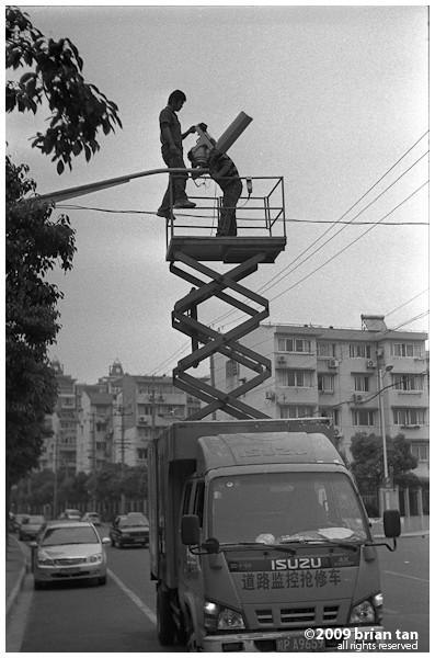 Repairing CCTV outside Wusong park