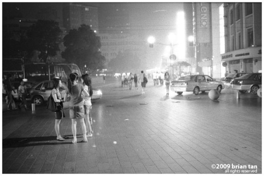 Late night shoppers hanging around Nanjing Rd way after all shops have closed.