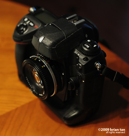 ... and compared to the Nikkor AIS on a pro body.