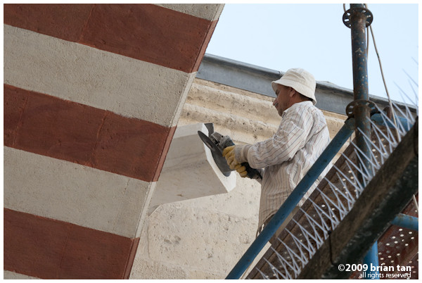 Uc Serefeli: This worker is polishing the masonry